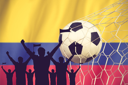 silhouettes of Soccer fans with flag of Columbia .Cheer Concept vintage color