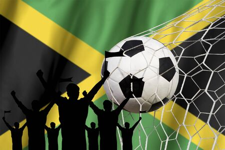 jamaican man: silhouettes of Soccer fans with flag of Jamaica .Cheer Concept