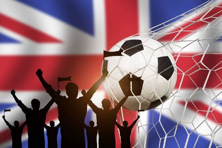 cross match: silhouettes of Soccer fans with flag of United Kingdom.Cheer Concept