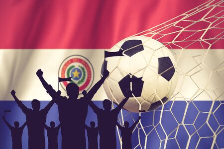 winning pitch: silhouettes of Soccer fans with flag of Paraguay .Cheer Concept vintage color