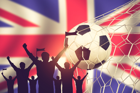 cross match: silhouettes of Soccer fans with flag of United Kingdom.Cheer Concept vintage color