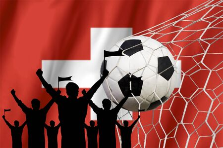 soccer fans: silhouettes of Soccer fans with flag of Switzerland .Cheer Concept