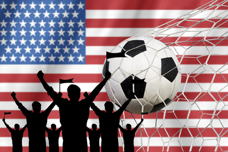 soccer fans: silhouettes of Soccer fans with flag of USA .Cheer Concept Stock Photo