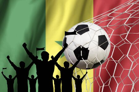 silhouettes of Soccer fans with flag of Senegal .Cheer Concept