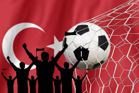 soccer fans: silhouettes of Soccer fans with flag of Turkey .Cheer Concept Stock Photo