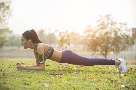 young woman, exercise in gardent background Stock Photo
