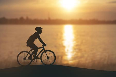 siluetas: Silhouette of a man on muontain-bike, sunset Stock Photo