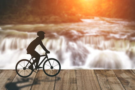 Silhouette of a man on muontain-bike, sunset Stock Photo