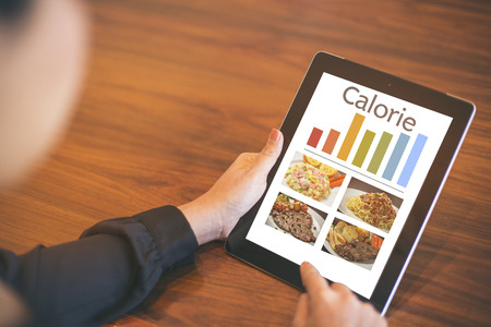 healthy eating, dieting, calories counting and weigh loss concept - close up of tablet pc screen
