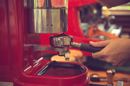 coffee blender: porta filter espresso machine in coffee shop background. Vintage color