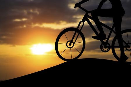 siluetas: Silhouette of a woman on muontain bike, sunset. Stock Photo