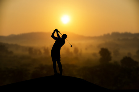 silhouette of golfers hit sweeping and keep golf course in the summer for relax time Stock Photo