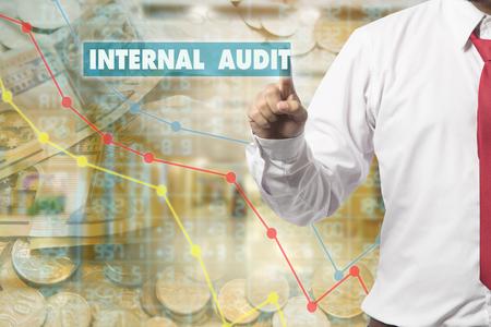 internal audit: Businessman pressing touch screen interface and select Internal audit. Business concept. Internet concept.