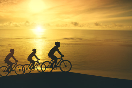 Empty Copy Space Sporty company friends on bicycles outdoors against sunset Silhouette five 3 cyclist going along shoreline coast Reflection sun on water Sport in Nature background Group of people