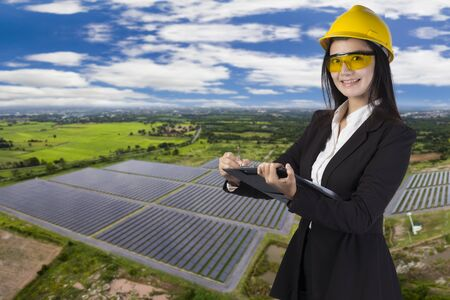 Young adult doing professional training on solar panels plant Stock Photo
