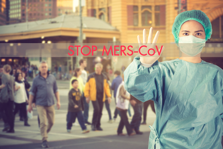 Open hand raised, Stop MERS-CoV (Middle East Respiratory Syndrome Coronavirus) sign painted,Stop  MERS-CoV concept.Vintage color