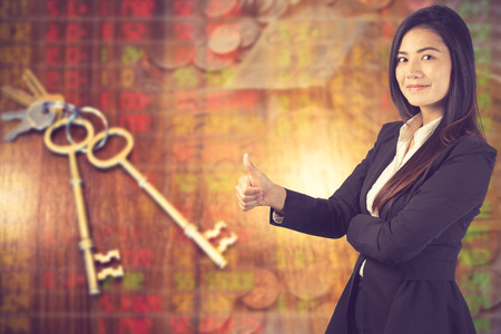 business woman show thumbs up on business background.concept key to success.Vintage color Reklamní fotografie