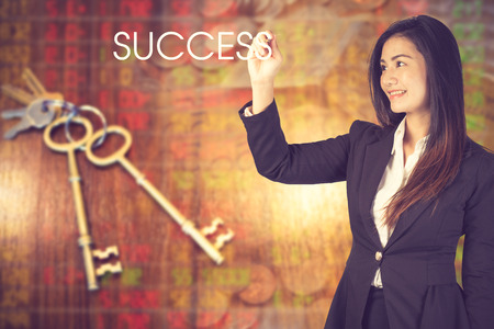 Businesswoman standing with back and making word success.concept of key to success.Vintage color Reklamní fotografie