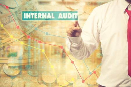internal audit: Businessman pressing touch screen interface and select Internal audit. Business concept. Internet concept.Vintage color