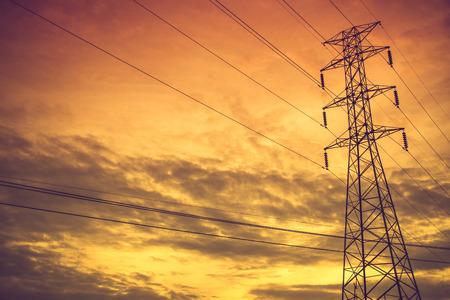high voltage post.High-voltage tower sky background.Vintage color