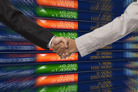 stock chart: Handshake over stock market chart