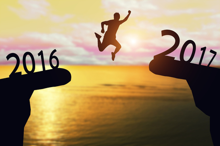 Silhouette A man jump between 2016 to 2017 years.