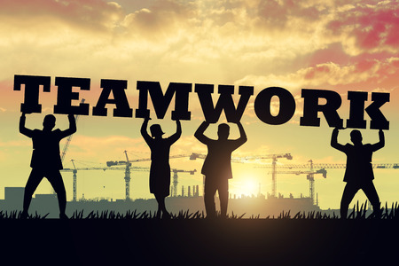 cooperate: Cooperate for successful work.Teamwork concept Stock Photo