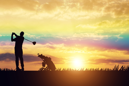 silhouette Man playing golf on a golf course in the sun Stock Photo