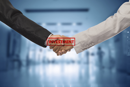 investor businessman handshake together:agreement,accept,approve financial cooperative. Stock Photo