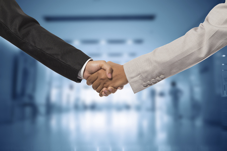 concede: investor businessman handshake together:agreement,accept,approve financial cooperative. Stock Photo