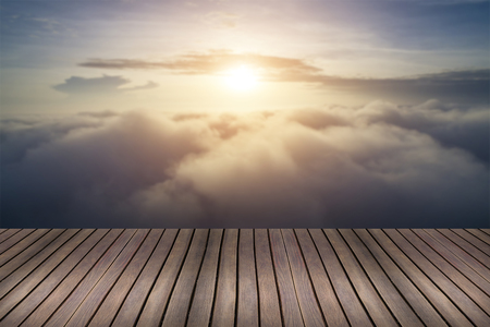 Wood table top with blurred beautiful cloudscape- can be used for display or montage your products