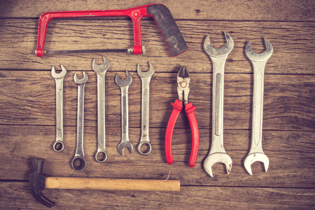 rusty nail: old tools on wooden background.Vintage color Stock Photo