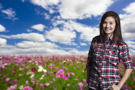Young women standing in a field of flowers background