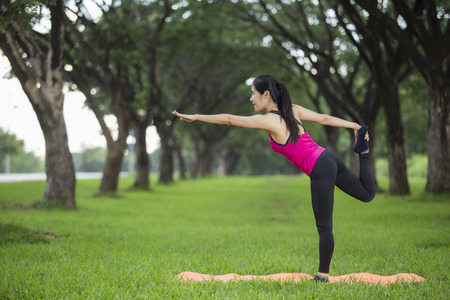 texturized: Young woman practicing yoga in park