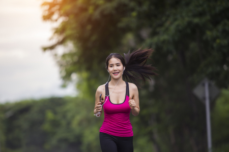 Beautiful woman running in forest