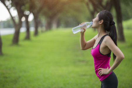 woman drink water from the exercise.
