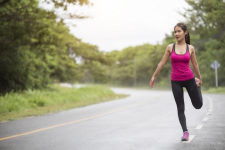 woman runner warm up outdoor Reklamní fotografie - 102572367