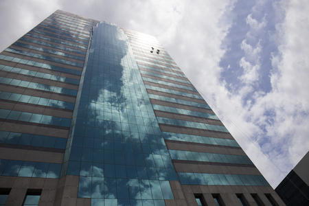 group of workers cleaning windows service on high rise building Reklamní fotografie