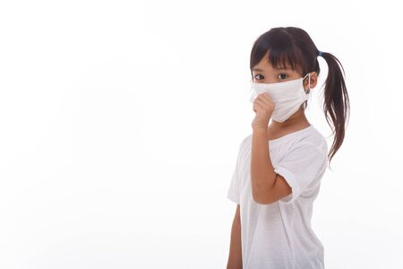 asia women wearing mask to prevent the virus PM2.5, Coronavirus, (2019-nCoV) asian little girl feeling unwell and coughing as symptom for cold or pneumonia,bronchitis. healthcare concept.on white background Фото со стока