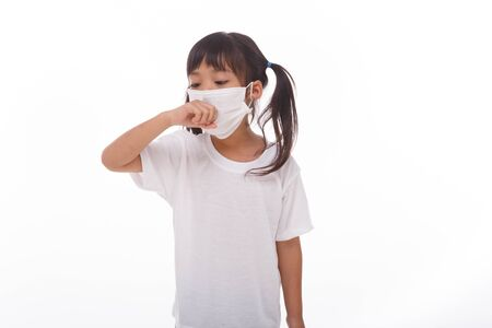 asia women wearing mask to prevent the virus PM2.5, Coronavirus, (2019-nCoV) asian little girl feeling unwell and coughing as symptom for cold or pneumonia,bronchitis. healthcare concept.on white background Standard-Bild