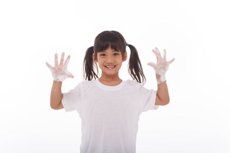 child washing hands and showing soapy palms.on white background