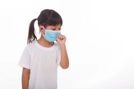 asia women wearing mask to prevent the virus PM2.5, Coronavirus, (2019-nCoV) asian little girl feeling unwell and coughing as symptom for cold or pneumonia,bronchitis. healthcare concept.
