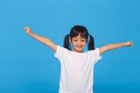 little girls raising their two hands up