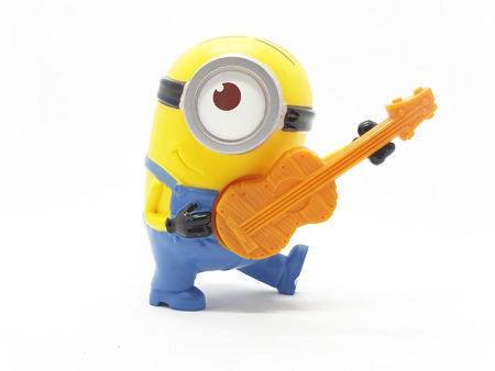 Minions toy isolated on white background an action figure from Despicable Me series animated 3D film produced by Illumination Entertainment for Universal Pictures