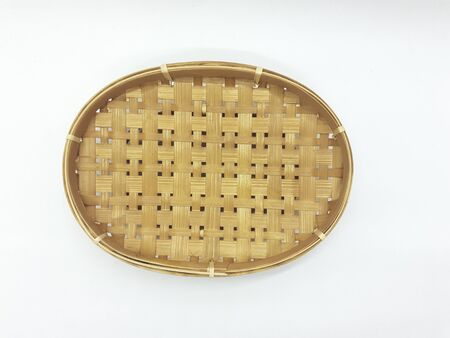 Traditional Ethnic Artistic Brown Wooden Handmade Bamboo Rattan Basket Container Tray for Home Interiors Decoration in White Isolated Background