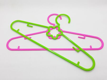 Various Bright Colorful Plastic Hanger for Clothes Drying Room Appliances in White Isolated Background