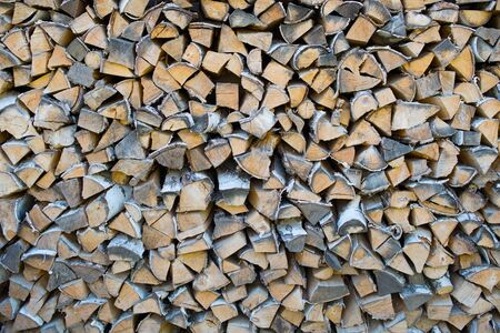 firewood background: a very big pile of firewood background Stock Photo