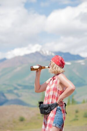 red bandana: girl in the red bandana drinking beer in nature