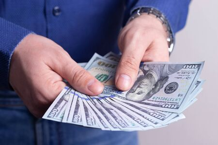 Money in the wallet of a successful man