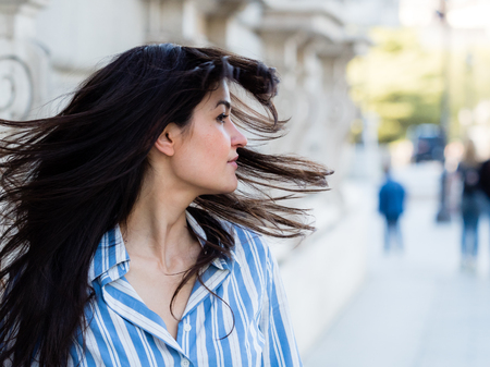 to rebel: Rebel brunette woman moving his hair happily Stock Photo